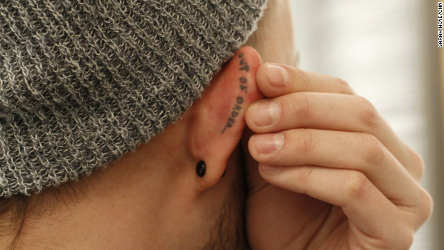 """A tattoo on Wilde's right ear reads, """"Out of Order."""""""