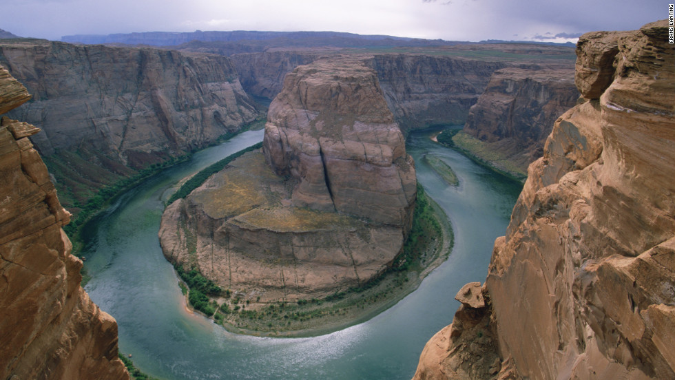 "Called ""King Bend,"" by locals, the U-shaped meander of the Colorado River known to the world as Horseshoe Bend flows 1,000 feet below the overlook."