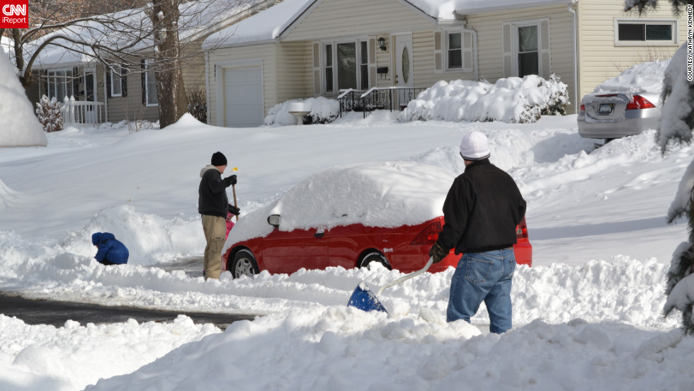 Twelve to 14 inches of snow fell in northeastern Kansas on Thursday, February 21. However, on Friday, February 22, the sun was out, and this street had been cleared, but many were not. Neighbors worked to clear their driveways while the kids enjoyed playing the deepest snow many of them had ever experienced.
