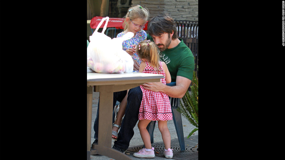 Ben Affleck takes his daughters Violet and Seraphina, born in 2009, to the Brentwood Farmers Market in Los Angeles.