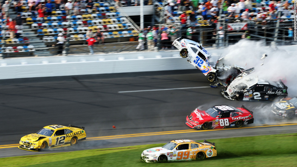 Kyle Larson, driver of car No. 32, and Brian Scott, driver of car No. 2, collide at the finish of the NASCAR Nationwide Series DRIVE4COPD 300 at Daytona International Speedway on Saturday, February 23 in Daytona Beach, Florida.