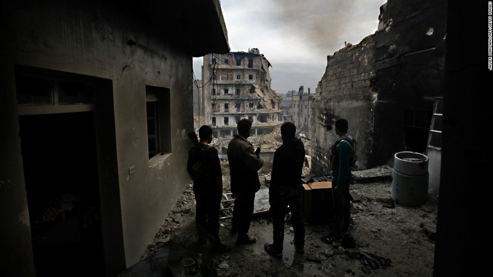 Members of Liwa (Brigade) Salahadin, a Kurdish military unit fighting alongside rebel fighters, monitor the area in the besieged district of Karmel al-Jabl in Aleppo on December 6, 2012.