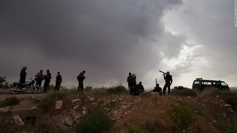 Syrian rebels take position near Qusayr on May 10, 2012.