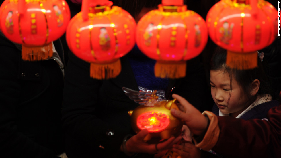 A young girl looks at lanterns in Yuyuan Gardens in Shanghai on February 24.