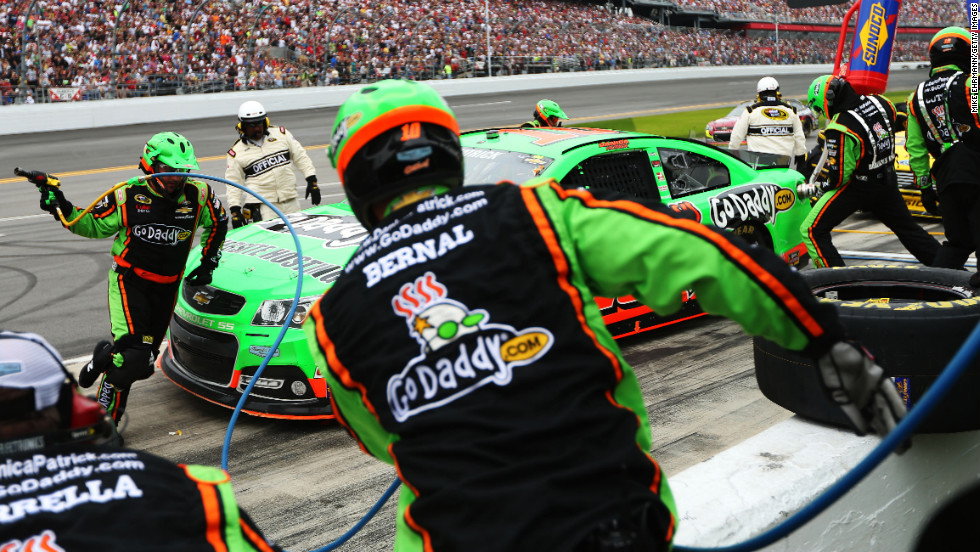 "No. 10 Danica Patrick pits during the Daytona 500. She made history when she became the first woman to <a href=""http://www.cnn.com/2013/02/17/sport/daytona-500-qualifying/index.html"">secure the pole position</a> for the race."
