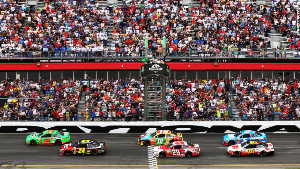 Danica Patrick, far left, leads the field past the green flag to start the Daytona 500.