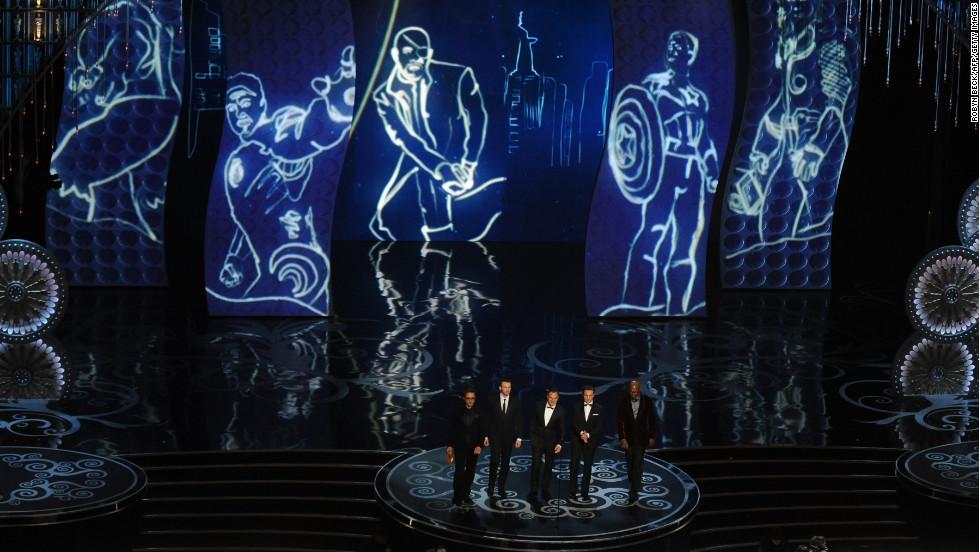"""Avengers"" actors Robert Downey Jr., Chris Evans, Mark Ruffalo, Jeremy Renner and Samuel L. Jackson present the Oscar for cinematography."