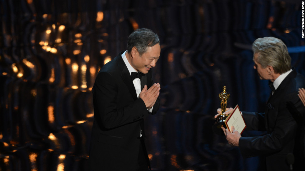"Director Ang Lee accepts the Oscar for best director for ""Life of Pi."""