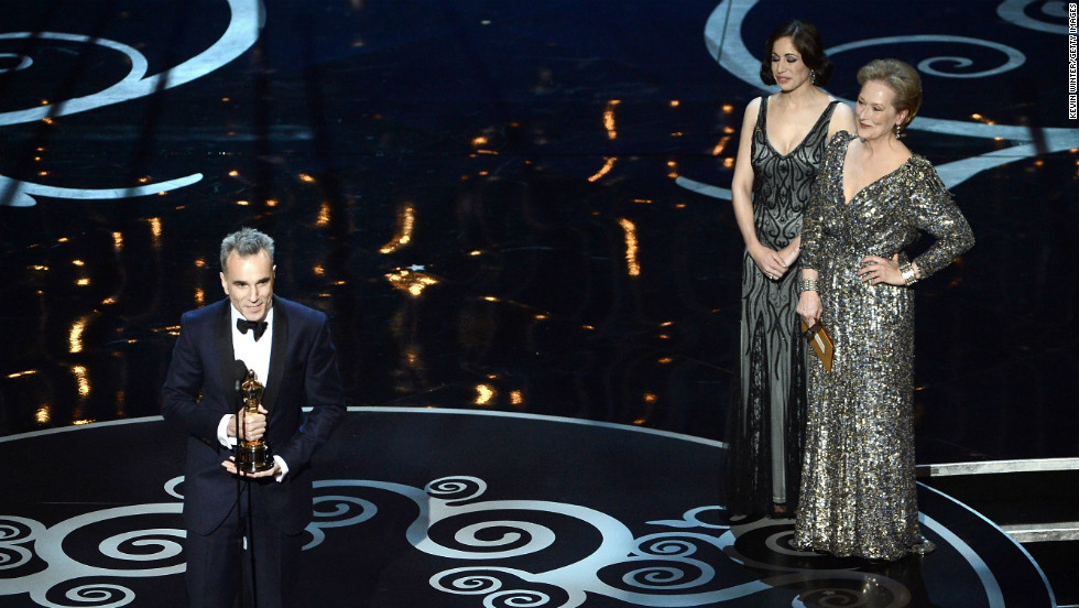 "Daniel Day-Lewis accepts the best actor Oscar ""for my mother"" from presenter Meryl Streep."