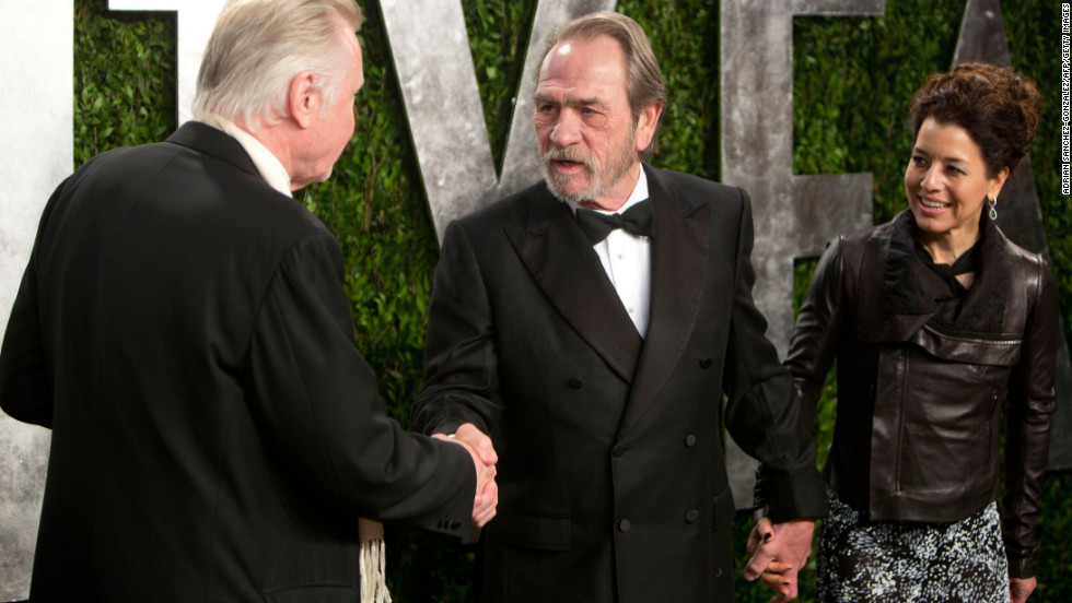 Tommy Lee Jones, center, is greeted by Jon Voight at the 2013 Vanity Fair Oscar party.