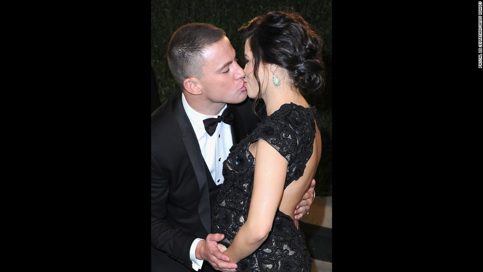 Channing Tatum and Jenna Dewan kiss at the 2013 Vanity Fair Oscar party.