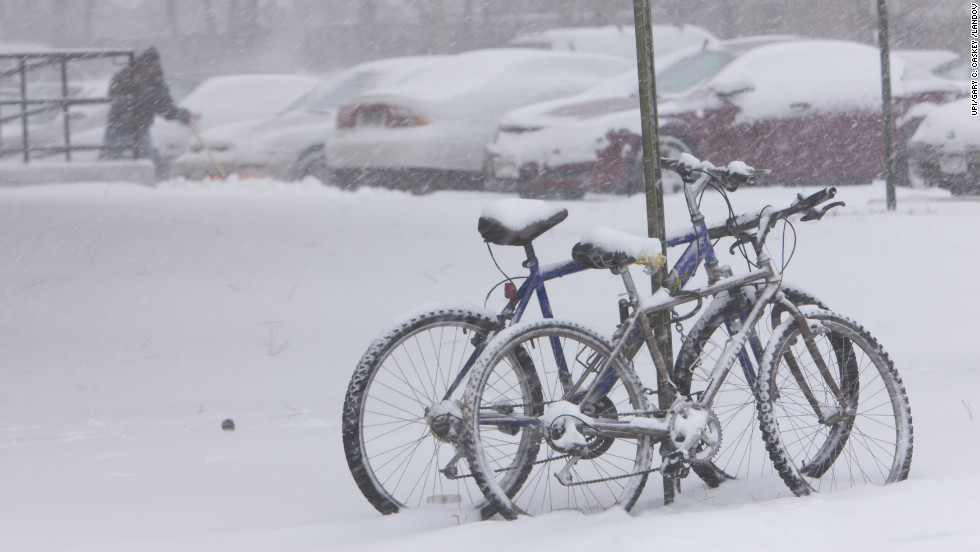 Bicycles gather snow during a storm in Denver on February 24.