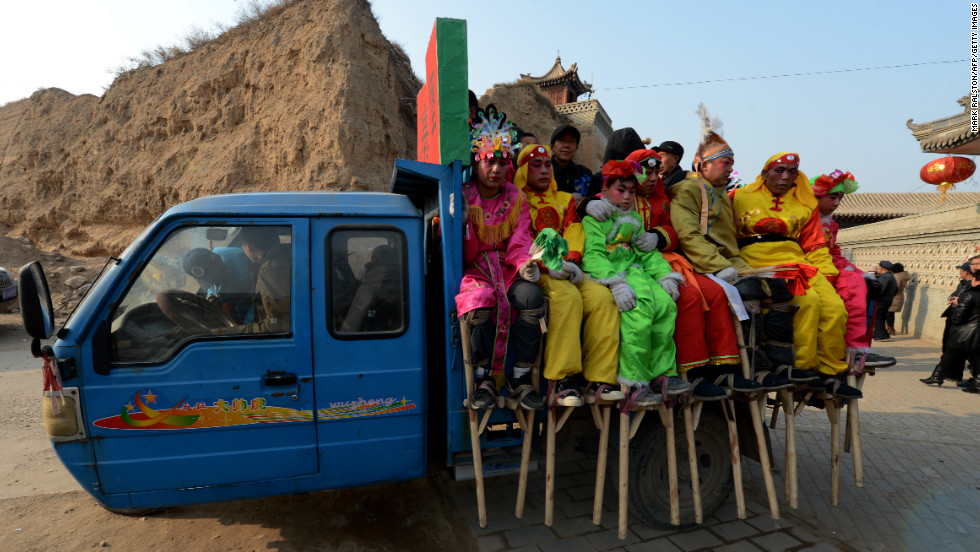 Entertainers get ready to be taken to a Lantern Festival parade in Nuanquan, China, on February 24.