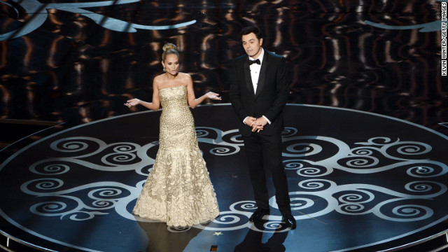 Kristin Chenoweth and host Seth MacFarlane perform a song for the Oscar losers during the credits.