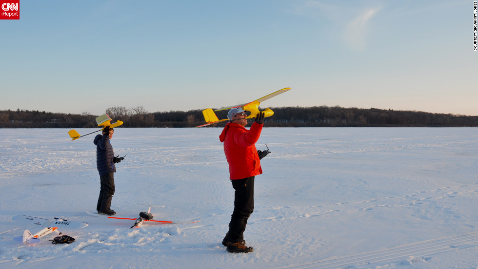 "iReporter <a href=""http://ireport.cnn.com/docs/DOC-932508"" target=""_blank"">Giovanny López</a> captured this father and son moment as they flew model airplanes over Lake Wingra in Madison, Wisconsin."