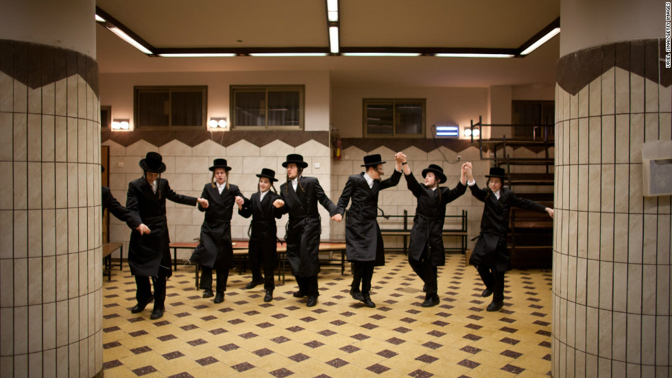Ultra-Orthodox Jews celebrate Purim at a synagogue. Dancing is a vital part of the celebrations...