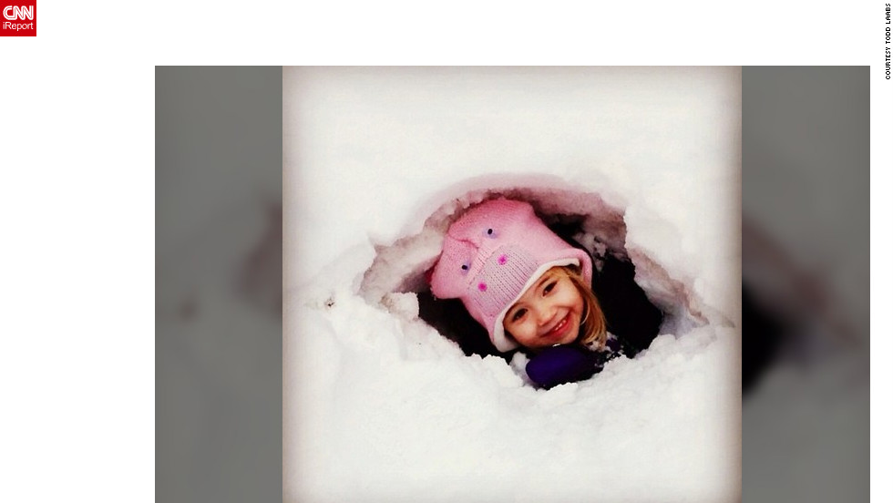"<a href=""http://ireport.cnn.com/docs/DOC-932876"" target=""_blank"">Todd Laabs</a> snapped this photo of his adorable 4-year-old daugther in his backyard in Minneapolis over the weekend. ""We have accumulated quite a big snow pile in our yard and it's perfect for digging snow forts,"" he said. ""We lived in California for several years, so the kids are loving the snow this year.""<br />"