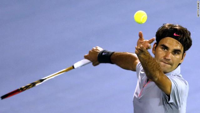 Switzerland's Roger Federer serves against Malek Jaziri as he eyes his sixth Dubai Tennis Championships title