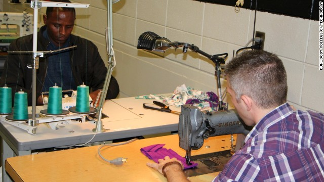 Students learn industrial cutting and sewing in a training program organized by a coalition of businesses and industry partners.