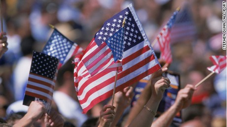 22 Sep 2001: American Flags are waved by the crowd during the game between the Ohio State Buckeyes and the Califonia Los Angeles (UCLA) Bruins at the Rose Bowl in Pasadena, California. The Bruins defeated the Buckeyes 13-6.Mandatory Credit: Stephen Dunn /Allsport