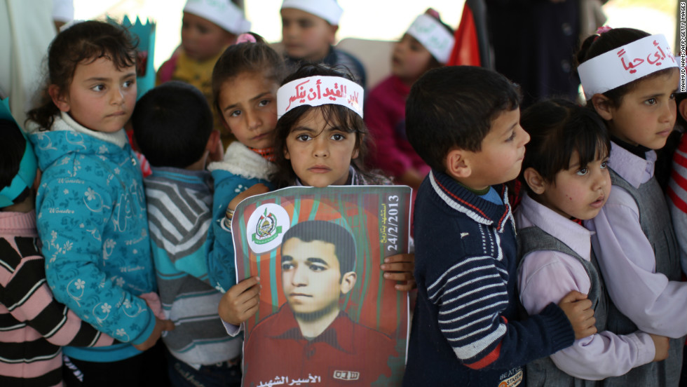 A Palestinian girl carries a poster of Arafat Jaradat at Erez border crossing between Israel and the northern Gaza Strip.