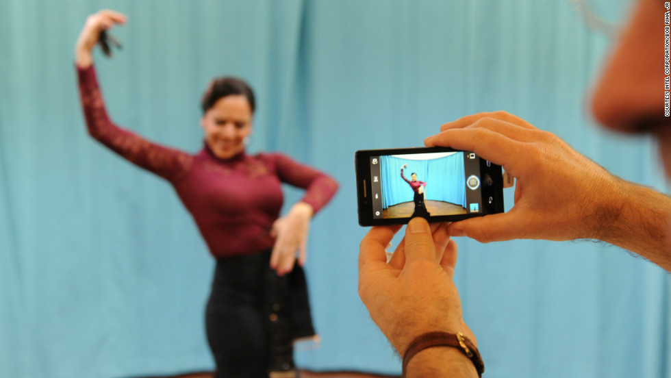 A flamenco dancer performs for visitors at the Mobile World Congress to demonstrate the imaging capabilities of Intel's latest smartphone design.