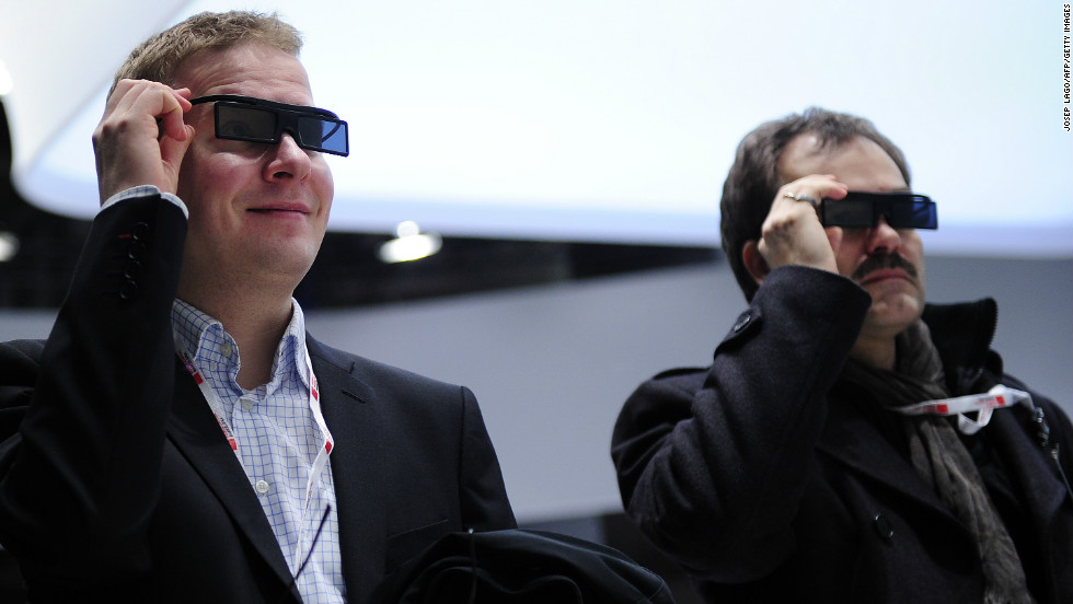 Two men test a new Samsung 3D device during the first day of the Mobile World Congress.