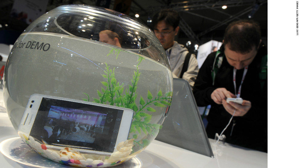 Chinese tech giant Huawei exhibits its water-resistant Ascend D2 smartphone in a fishbowl at their stand at the Mobile World Congress.