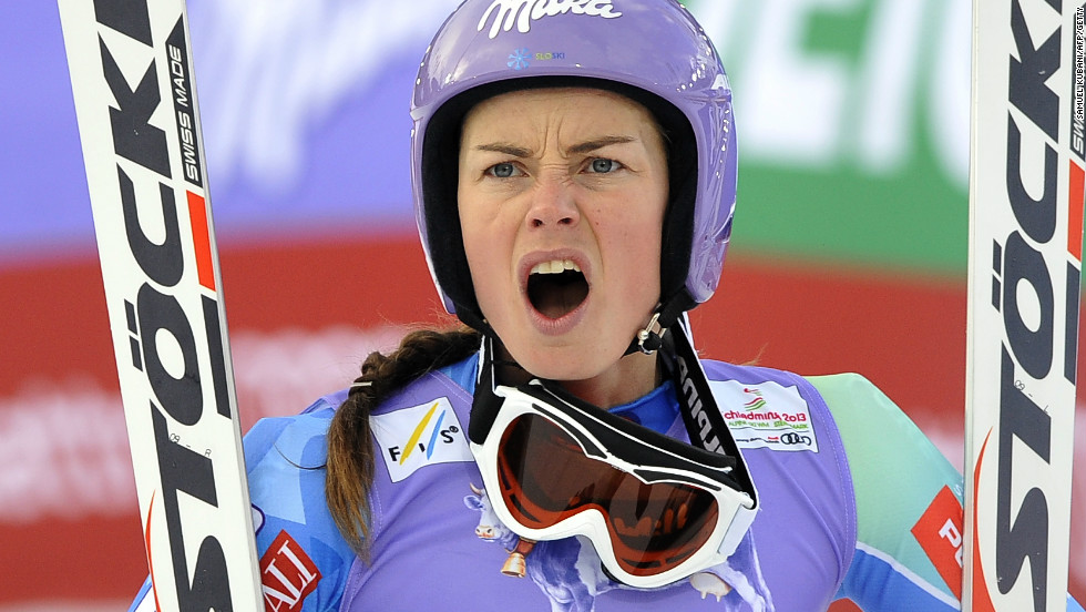 Before her victory, Maze looks on in horror as rival Lindsey Vonn suffers a serious accident on the opening day of competition in Austria.