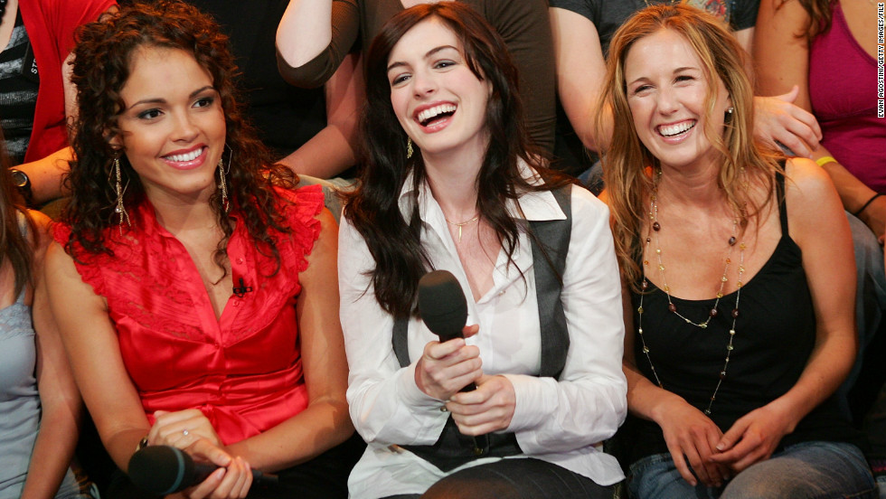 "Hathaway shares a laugh with VJ Susie Castillo, left, and her cousin Meredith Shevory on MTV's ""Total Request Live"" in 2006."