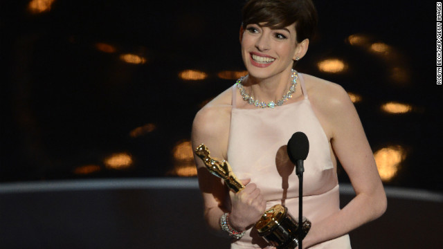 Best Supporting Actress winner Anne Hathaway addresses the audience onstage at the 85th Annual Academy Awards on February 24, 2013 in Hollywood, California. AFP PHOTO/Robyn BECK        (Photo credit should read ROBYN BECK/AFP/Getty Images)
