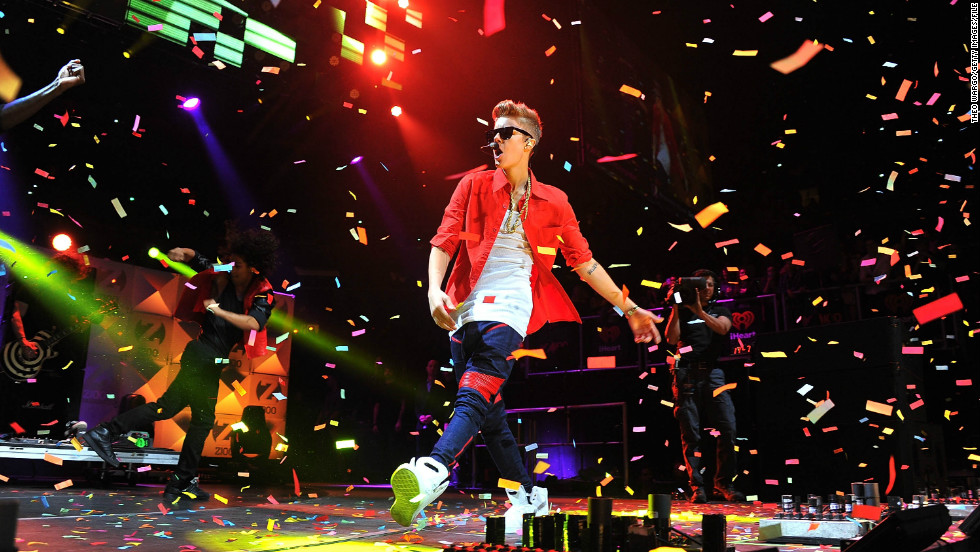 "As of March 1, Justin Bieber has just one more year to claim the ""teen"" in his pop star title. To celebrate the singer's 19th birthday, we look back at his rise to fame in 19 other photos -- plus an extra one for good luck."