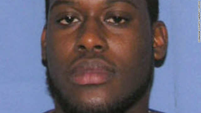 Lawrence Reed, 22, has been charged in the murder of Marco McMillian, authorities said.