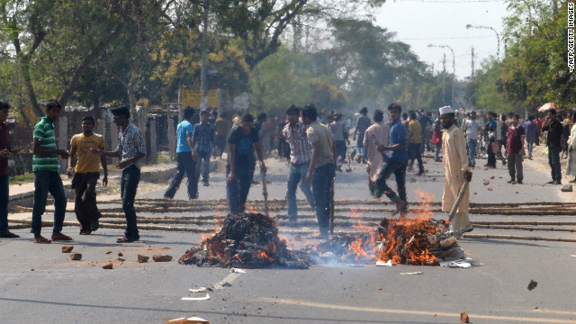 Jamaat-e-Islami activists set fires in the street during a clash with police in Rajshahi, north-west from Dhaka on Thursday.