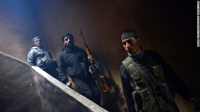 Rebel fighters take position to fight against pro-government forces in  Aleppo on February 9, 2013.