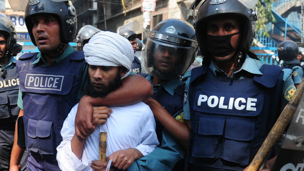 Bangladeshi police detain an Islamist activist during clashes in Dhaka on February 22.