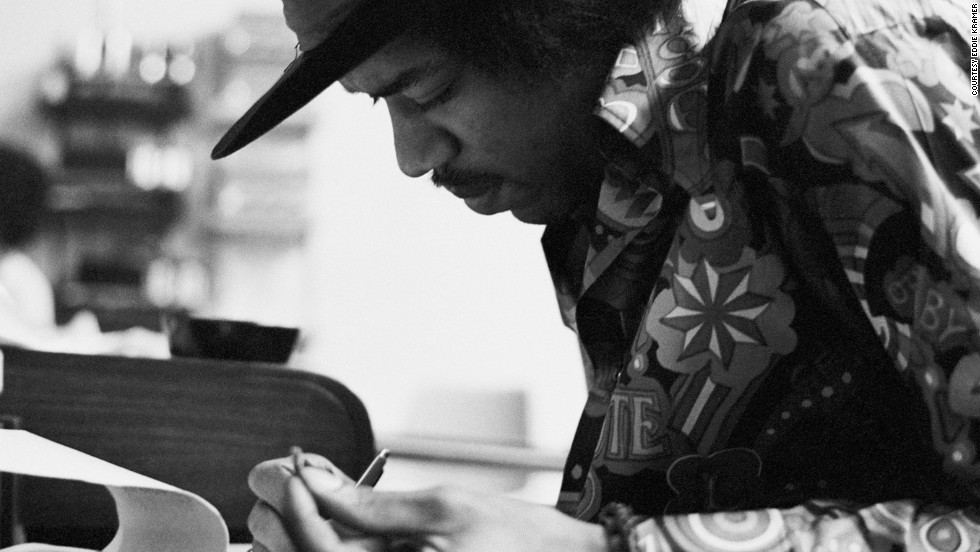 "<strong>Hendrix at the Record Plant in 1968:</strong><br />""Jimi had the habit of making the final draft of a song he was working on just before he went into the booth to record the vocal. This photo shows a smiling Jimi putting the final touches to 'Gypsy Eyes' from the many notes he kept with him usually written on hotel stationery, napkins or matchbook covers. These would be assembled on a yellow legal pad just prior to singing the final vocal. An interesting observation is that he wrote right-handed even though he played lefty.""  --<em> Eddie Kramer</em>"