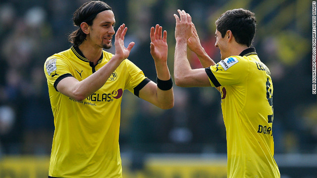 Robert Lewandowski (right) is congratulated by teammate Sebastian Kehl after scoring the second goal against Hannover.