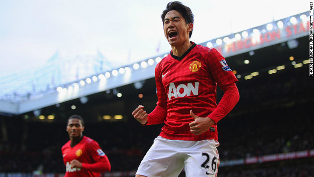 Shinji Kagawa celebrates scoring his third goal against Norwich City at Old Trafford on Saturday.