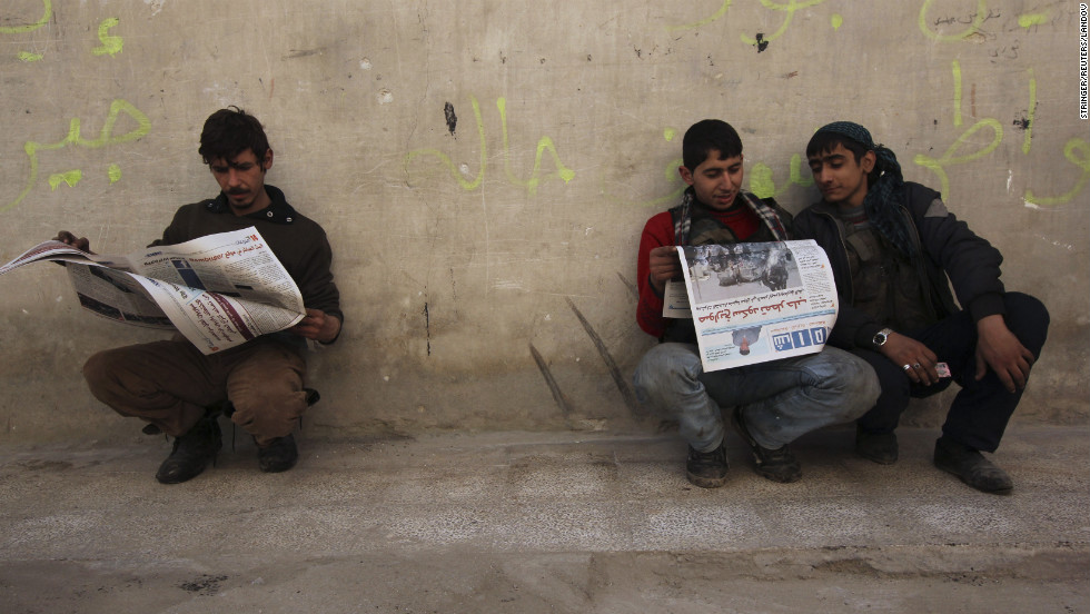 Residents read Shaam News newspapers published by the Free Syrian Army in Aleppo on March 2.