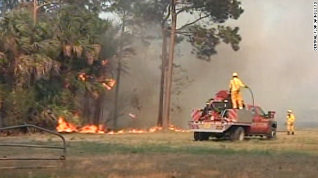 Firefighters seek to contain a portion of the blaze in Volusia County.