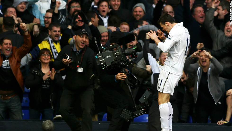 Gareth Bale poses in front of the television cameras after firing Tottenham into a 1-0 lead against arch rival Arsenal at White Hart Lane. The Welshman beat the offside trap before coolly slotting the ball into the net, leaving him free to produce his trademark heart shape celebration.