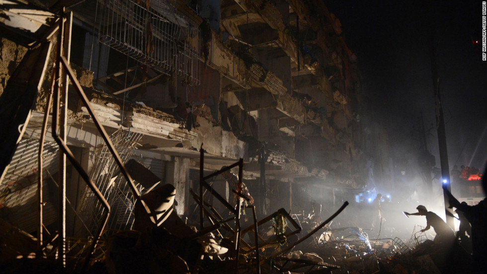Pakistani rescuers work at the blast site.