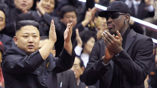 Former NBA star Dennis Rodman watches a basketball game with Kim Jong Un and his wife, Ri Sol Ju in Pyongyang, North Korea in February.