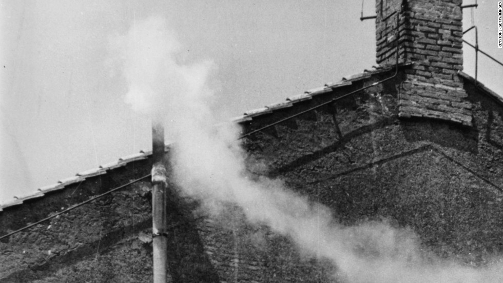 White smoke emanates from the Sistine Chapel chimney to indicate the election of a new pope in 1963.