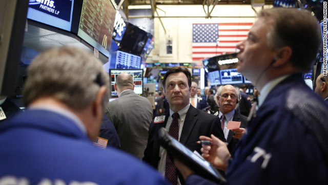 Traders work on the floor of the New York Stock Exchange, March 5, 2013.