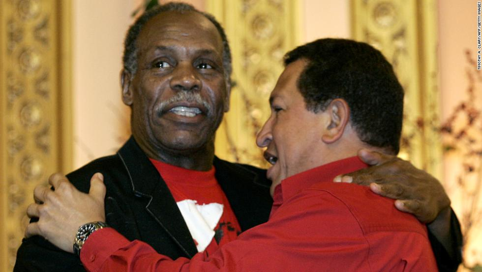 Actor Danny Glover and Chavez embrace while attending the The CITGO-Venezuela Heating Oil Program inauguration ceremony in Harlem, New York, on September 21, 2006. Chavez addressed the United Nations General Assembly a day earlier.