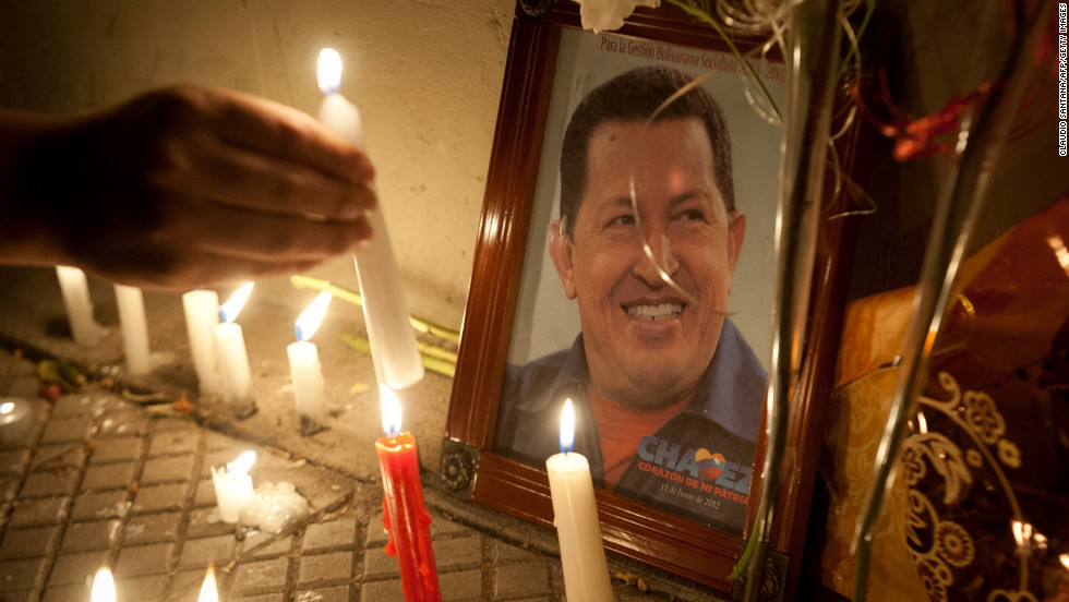 Supporters of Chavez light candles while gathering in front of the Venezuelan Embassy in Santiago, Chile, on Tuesday, March 5.
