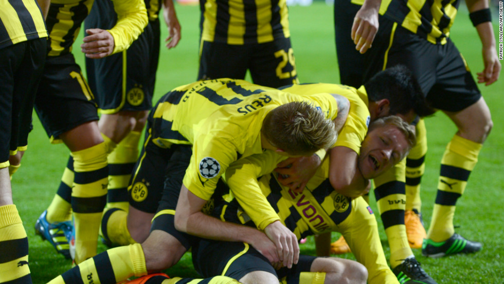 Dortmund's Polish midfielder Jakub Blaszczykowski is mobbed after scoring during his side's 3-0 win over Shakhtar Donetsk.