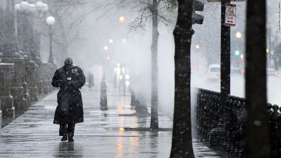 A man walks on 17th Street as snow and rain begin to fall on March 6 in Washington.